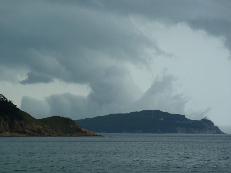 Над морем, накрывая полуостров Балюзек огромное облако выросло. | Ольгинский район