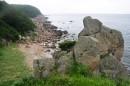 Соседняя бухточка с песочком и камнями.