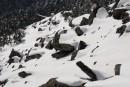 камни в снегу. Гора Пидан в апреле. Шкотовский район.