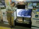 На мониторе - бухта Агатовая. Под монитором - выставка поделок из камня той же бухты.